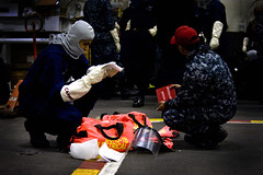 A Sailor reviews equipment during a drill. (Official U.S. Navy Imagery) Tags: usa heritage america liberty freedom commerce unitedstates military navy sailors fast worldwide va portsmouth tradition usnavy protect deployed flexible onwatch beready defendfreedom warfighters nmcs chinfo sealanes warfighting preservepeace deteraggression operateforward warfightingfirst navymediacontentservice
