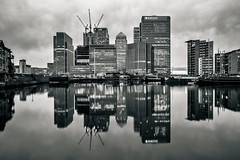 Lake Placid (Daniel Borg) Tags: camera city longexposure light england blackandwhite bw white black london architecture skyscraper reflections lights unitedkingdom wideangle calm symmetry docklands tall canarywharf statestreet hsbc barclays citi canadasquare londonatnight canon1022 hintofcolour danielborg canon550d cityandarchitecture