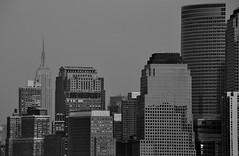 Greyscale (Belhaven2011) Tags: street nyc blackandwhite newyork streets reflection building glass architecture grey mono nikon manhattan gray monochromatic explore empirestatebuilding empirestate grayscale greyscale explored 55300 55300mm nikond5000 belhaven2011