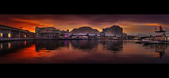 Darling Harbour Sunset || SYDNEY PANORAMA (rhyspope) Tags: blue sunset red panorama reflection building yellow skyline architecture night sunrise canon lights evening cityscape sydney australia darlingharbour cocklebaywharf 500d rhyspope