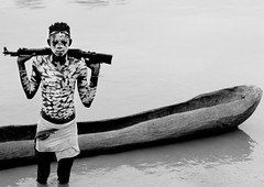 Young Karo Man With White Painted Faces And Chests Holding Kalashnikov Rifle In The Water Of The River  Near Pirogue Omo Valley Ethiopia (Eric Lafforgue) Tags: africa people water horizontal standing river rifle picture tribal photograph transportation blackpeople warrior omovalley ethiopia tribe carvedwood navigation woodcarving nomadic äthiopien kalashnikov etiopia onepersononly etiopía lookingatcamera manmen エチオピア etiopija ethiopië omoriver indigenousculture 埃塞俄比亚 etiopien etiópia 埃塞俄比亞 etiyopya אתיופיה snnpr southernethiopia 1718years truepeople эфиопия 에티오피아 exterioroutdoors αιθιοπία korcho omotic 이디오피아 種族 1920years етиопија 衣索匹亚 衣索匹亞 southernnationsnationalitiesandpeoplesregion blackethnicity karakarokerre bodypaintingnaturalpatterndesignritualbodyart whitepaintchalkpatternsdesignbodypaintingritualpowder ethiopianomovalley abyssiniahornofafrica blackandwhitephotoblackwhitepicturebw warwarfareconflictconfrontationencounterclashweaponsfiregunsriflesviolence ak47ak47weaponfirearmlethalriflefiregunkalashnikov canoeemptytrunkdugout conflictconfrontationwarwarfare southernnationsnationalitiesandpeoplesregionsnnpr ethio8301