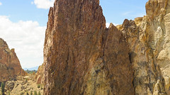Tiny Man (or Woman) and Smith Rock (bombeeney) Tags: weldedtuff ash volcanic volcano oregon smithrock a7r sony pano panorama panoramic zeissbatis85mm18 pacificnorthwest pnw wonder sevenwondersoforegon 7wondersoforegon rock geology