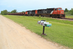 Not here to Deliver the mail (GLC 392) Tags: cn canadian national emd sd75i mi michigan tree iron ore train railroad railway 5741 u741 5779 jennies cars out door vehicle yard clouds trees southbound dirt road beaver old 35 mail box