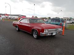 1966 Chevrolet Impala (blondygirl) Tags: showshine car auto celebrationchurch june19 fathersday carshow 15thannual yeg sa 2016 antiquecars sportcars musclecars imports trucks motorcycles rain raindrops 1966 chevrolet impala chevroletimpala red
