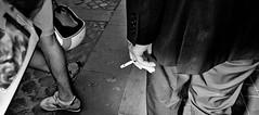 Two cultures. (Baz 120) Tags: candid candidstreet candidportrait city candidface candidphotography contrast streetfaces street streetphoto streetcandid streetphotography streetphotograph streetportrait monochrome monotone mono blackandwhite bw urban noiretblanc voigtlandercolorskopar21mmf40 life leicam8 leica rome roma romepeople romecandid romestreets primelens portrait people unposed italy italia girl grittystreetphotography flashstreetphotography faces flash decisivemoment strangers