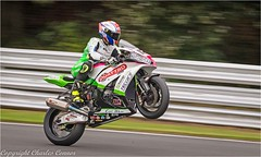 Winning Wheelie (cconnor124) Tags: england unitedkingdom gb motorbike motorbikeracing oultonpark racing speed wheelies wheels power track racetrack chesh colours colourful canon100400lens canoneos canon7dmk11
