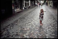 2nd of June 2016 (Paul of Congleton) Tags: june 2016 saintgillescroixdevie vende paysdelaloire france katherine katie girl child smile street paving olympus om4ti 35mm fujichrome sensia colour slide transparency film