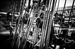 Pullys (BeetleBrained) Tags: blackandwhite bw water photoshop dark lens 50mm harbor boat dock nikon noir sailing ship sail mast nikkor vignette bnw cs5 d5100 siverefex