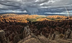 October Rain in Bryce (rschnaible) Tags: park red sky orange usa storm southwest west rain rock clouds landscape utah us rainbow day desert gray stormy national western hoodoo bryce hdr hoodoos nrpad