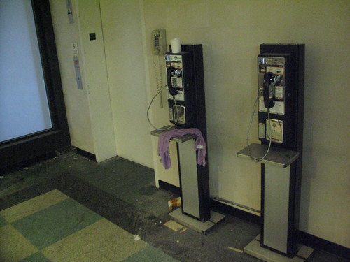 Payphones and a courtesy phone by the elevator