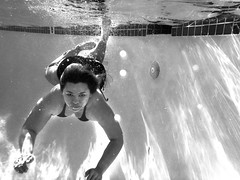 Candy Going Under in Oceanside (TheJudge310) Tags: california woman usa girl swimming swim hair long underwater candy bubbles oceanside latina