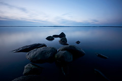 calm lake (Andreas Lf) Tags: longexposure blue sky lake nature water clouds reflections landscape rocks day quiet sweden empty horizon tripod peaceful nopeople calm clear le bluehour scandinavia minimalistic tranquil linkping uwa sigma1020mm stergtland ndfilter tvrskogsudde linsurf roxen lakescape ultrawideangle neutraldensity nordics lightcraftworkshopnd500 sonyalphaslta77