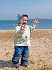 happy kid walking on the beach (Maxim Tupikov) Tags: life park boy sea baby cute green beach parenthood nature water smile face field grass childhood sport strand fun happy coast countryside kid spring clothing movement sand toddler infant child play little outdoor expression walk innocent young meadow son kind parent enjoy innocence friendly recreation