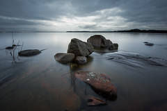Rocks & water - Bergviksudde (- David Olsson -) Tags: longexposure november sunset plants lake seascape cold nature water clouds landscape nikon rocks sundown cloudy sweden stones tripod karlstad le fx vnern 2012 scattered vrmland 1635 ndfilter d600 1635mm lakescape bergvik smoothwater orangerock davidolsson nd500 lightcraftworkshop 1635vr bergviksudde