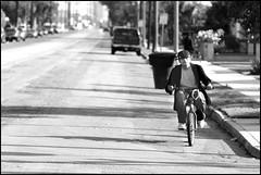Kid On A Bike (greenthumb_38) Tags: street boy blackandwhite bw bike bicycle blackwhite kid streetphotography duotone anaheim youngman olivestreet jeffreybass