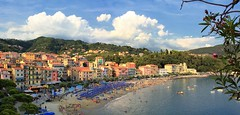 Golfo dei Poeti, panoramic view of the town San Terenzo (Bn) Tags: pink blue trees houses sunset sea summer vacation sky italy panorama orange holiday seascape green castle beach water colors beauty yellow pine clouds swimming walking bay coast la oak sand ancient topf50 san italia hiking turquoise magic liguria charm tourist panoramic medieval historic hills vista colored lush viewpoint colori multi parasols lerici swimmng spezia ligurian liguri 50faves terenzo towerhouses panview golfdeipoeti