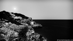 Over the moon (byVini photography) Tags: sea blackandwhite cliff moon house black beach nature water rock vertical night landscape outdoors photography dawn spain europe hill tranquility nopeople fullmoon tropical coastline geology mallorca atlanticocean scenics rockformation tranquilscene beautyinnature extremeterrain nocloud physicalgeography holidaydestination calamondrago housebythesea photo4me viniciosdemoura byviniphotographycom houseoverthehill