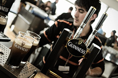 Bartender and two pints of Guinness at the Gravity Bar inside the Guinness Storehouse - Dublin (PascalBo) Tags: ireland people dublin man beer museum bar nikon europe capital indoor muse guinness indoors capitale gravitybar homme bire stout irlande guinnessstorehouse d300 ire pascalboegli