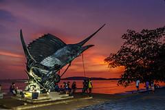 Sunset in Krabi, where the Sailfish Roam Free (Anoop Negi) Tags: aonang ao nang krabi thailand sailfish statue sunset red beach ocean night shot twilight photo photography anoop negi travel art sculpture fishing culture