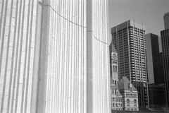 City Hall and Old City Hall, Toronto (Richard Wintle) Tags: foma fomapan 200 adox adonal bw blackandwhite monochrome film 135 35mm canon sureshot sureshotmax 38mm f35 toronto ontario canada cityhall