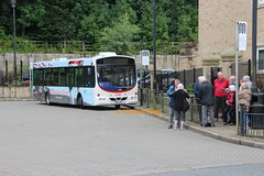 Are we tourists or are we dancer? (SelmerOrSelnec) Tags: rossendale scania l94ub wright yn05gxv uppermill britanniacoconutdancers reading bus