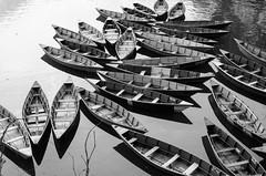 boats (aaronjherron) Tags: pokhara waterreflections disorderimages blackandwhite