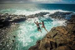 Jumping at the Queen's Bath, Kauai (tibchris) Tags: kauai hawaii queensbath swimming ocean couple jump outdoors landscape dangerous adventure princeville loversleap danger northshore