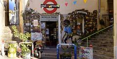 Street of Marseilles - A store (KristHelheim) Tags: fujifilmx100t fujix100t fujifilm fuji france marseille streetart street streetofmarseilles velvia rue city ville lepanier streetphotography tag graffiti 35mm