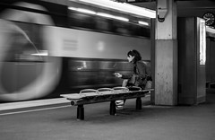 7:49 pm (Lens a Lot) Tags: carl zeiss planar 50mm 14 t aej mid 70s | 6 blades iris cy mount f14 black white street photography train gate station people bench smoking vintage manual fixed prime lens german germany