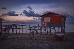 The red house (Syahrel Azha Hashim) Tags: horizon nature sony 2016 shallow holiday nopeople malaysia housesonstilts beach details dramaticsky semporna sabah boat ilce7m2 dof woodenhouse denawanisland sunrise local sonya7 getaway handheld 35mm colorimage vacation a7ii prime light fishingvillage naturallight fishingboat colorful ocean beautiful travel syahrel houses clothes colors simple hanged clouds island detail