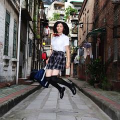 Jumping Girl (Delie.An) Tags: guangzhou 6x6 girl jump jumping chinese lane schooluniforms chinesegirl 40d japaneseschooluniforms