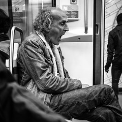 pressure adjustment (tavekapa) Tags: blackandwhite bw man paris subway square sitting metro candid profile yawn bored streetphotography boring tired fujifilm 1x1 x100 500x500 pressureadjustment