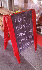 dad joke (Burnt Out Chevrolet) Tags: street new november red white signs black silly sign chalk crazy jump funny board sony humor free humour zealand nz string strings bungy hastings alpha a200 attached 2012 heretaunga