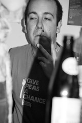 Give peas a chance (Gary Kinsman) Tags: shadow party bw london houseparty blackwhite bottle wine zoom camden cigarette candid smoke flash tshirt smoking telephoto canon350d 2008 canonrebelxt camdentown nw1 camdenroad givepeasachance sigma18125mm