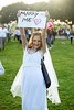 A fan dressed in a wedding dress with a sign 'Marry Me' during the Justin Bieber concert
