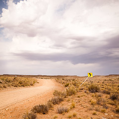 Ten Mile Road (Chicken) Tags: road usa cloud sign square utah unitedstates desert cloudy overcast highdesert getty moab thunderstorm dirtroad curve left backroad leftturn