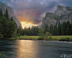A New Day (James L. Snyder) Tags: california park morning blue trees usa sun sunlight painterly mountains green water field grass horizontal wall clouds forest sunrise river gold early waterfall nationalpark spring shiny glow view purple cloudy may meadow falls cliffs sierra glorious evergreen pines shore valley yosemite vista sunburst glowing verdant rays yosemitenationalpark peaks dreamlike riverbank elcapitan sierranevada shrubs 2009 luminous brilliant radiant gleaming backlighting shimmering sunbeams valleyview monoliths yosemitevalley riparian crepuscular mercedriver spectacle cathedralrocks bridalveilfall glimmering mariposacounty lustrous gatesofthevalley bridalveilmeadow