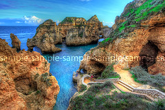 Grottos at Ponta Piedade (manateevoyager) Tags: blue winter red cliff plants lighthouse green portugal nature birds yellow trek faro sandstone europe arch view natural walk sold scene hike lagos erosion vista grotto ravine archway algarve sales homedecor hdr vilamoura worldheritage portimao manateevoyager nigelhamer alburfeira pointepiedade