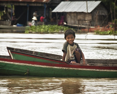 Smiling kid on a canoe (BenDem) Tags: poverty wood travel vacation portrait sky people house lake tourism home nature water rural river landscape asian outdoors person pier boat wooden fishing fisherman asia cambodia ship cambodian khmer village buddhist traditional transport poor culture floating bamboo national siem reap tropical tropic raft nautical tradition float angkor bungalow sap tonle