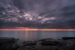 Stony Point (nicholasjon) Tags: lakesuperior stonypoint lake clouds dawn sunrise rocks orange gray wind longexposure
