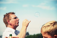 Young@Heart (catarinae) Tags: children game child old man portrait soap bubble city blue sky sunny germany deutschland berlin playing age blow beer blonde young heart