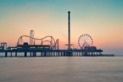 Pier-Sunrise (Ray Devlin) Tags: texas lonestarstate gulfofmexico coastaltexas coastal usa america shoreline sea galvestonisland galveston historic pleasure pier galvestonhistoricpleasurepier seaside jetty fairground rides bigwheel silhouette sunrise beach long exposure