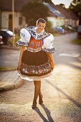 Keeping tradition alive: young woman in a richly decorated ceremonial folk dress/regional costume (Kyjov folk costume, Southern Moravia, Czech Republic) (Theess21) Tags: attractive beautiful blue bright central ceremonial color colorful colour colourful costume country countryside czech decorated decoration dress eastern embroided embroidery europe female flower folk garments girl handmade historical kyjov lit moravia national pretty red region regional republic rich slavic southern stunning sunlight tradition traditional village vine vineyard wine woman young