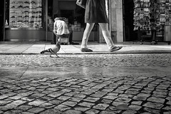Urban ground (Fernando_PC) Tags: street woman portugal standing walking photography blackwhite flickr downtown photographer close pov pigeon lisbon candid low streetphotography ground fujifilm ontheground baixa seating x10 streetphotographer lowpov 500px juststreet fujifilmx10 fernandopc