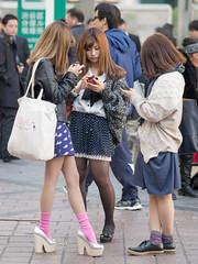 Everybody's touching it (kasa51) Tags: street city people girl japan digital tokyo olympus f18 omd iphone 75mm em5 mzuiko 髪の量が多い