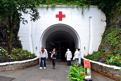 Entrance to Underground Hospital Museum (Tailothebank) Tags: world history sign museum hospital underground islands rust war view barrels rusty enigma bunker german jersey artillery guns tunnels fortifications 1945 channel 1939 weapons redcross cannons militaria codes ho8 germanundergroundhospital