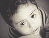 (Proleshi) Tags: boy blackandwhite cute face 50mm bigeyes nikon child stripes 14 50 afs d300s proleshi jamaljosephs
