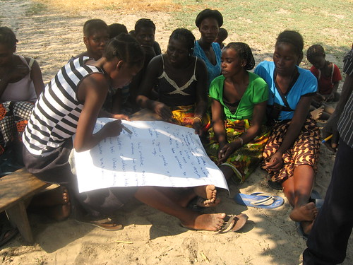 Female youths in a community conversation in Nanikelako, Mongu District, Zambia. Photo by  Jeston Kalembwe, 2012.