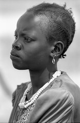 Ethiopia : Soudanese Nuer girl (foto_morgana) Tags: africa portrait people woman beauty face female outdoors necklace looking serious native african character traditional young earring tribal lips jewellery omovalley tribe ethnic nikoncoolscan analogphotography attentive lookingaway ethnicity blackwoman headandshoulders dimma refugeecamp blackwhitephotography humanface beadednecklace vuescan kodaktmax400cn afrotexturedhair braidshairstyle