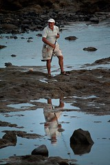 Evening Fisher Man (gemini2546) Tags: reflection evening fisherman tenerife shorts beachfishing sandles canon500d basballhat
